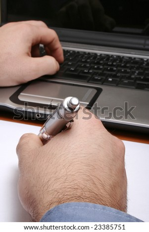 Hand typing/writing with computer keyboard, mouse, and monitor. Represents computer work at office-school-home, and/or researching-surfing the internet - stock photo