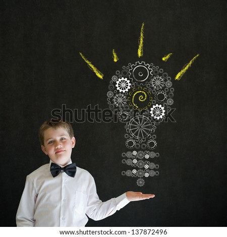 Hand up answer boy dressed up as business man with bright idea gear cog lightbulb on blackboard background - stock photo
