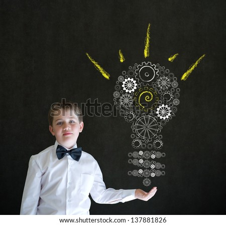Hand up answer boy dressed up as business man with bright idea gear cog lightbulb on blackboard background