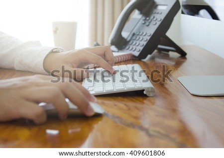 Hand use keyboard and mouse for control computer - stock photo