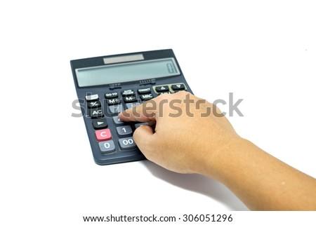 Hand using calculator isolated on white background - stock photo