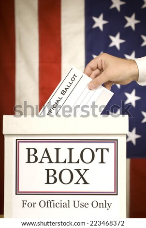 Hand Voting At Ballot Box/ Vertical Shot