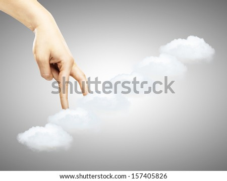 hand walking up the stairs clouds - stock photo