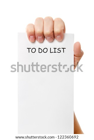Hand was holding of a to do list paper note isolated on white background - stock photo