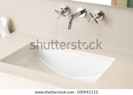 Hand wash basin with faucet - stock photo