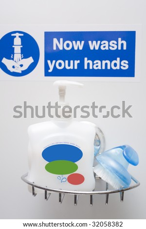 Hand wash stations are now everywhere in hospitals, restaurants, food production facilities. - stock photo
