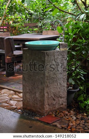 Hand washing basin in the garden, antique and retro style - stock photo