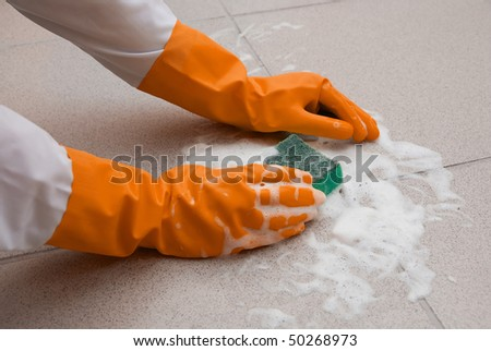 hand washing floor by cleaning sponge with foam - stock photo