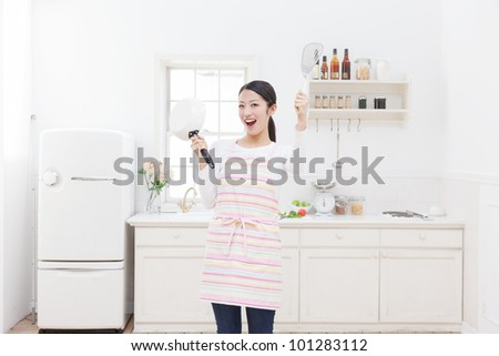 Hand-washing sink in the hands of a woman by the window - stock photo