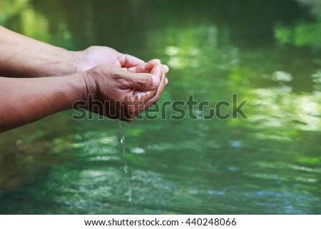 Hand watering for drink in rainforest. - stock photo
