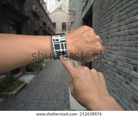 hand wear smartwatch with map guide on street background - stock photo