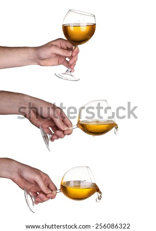 Hand wine splash in glass isolated on white