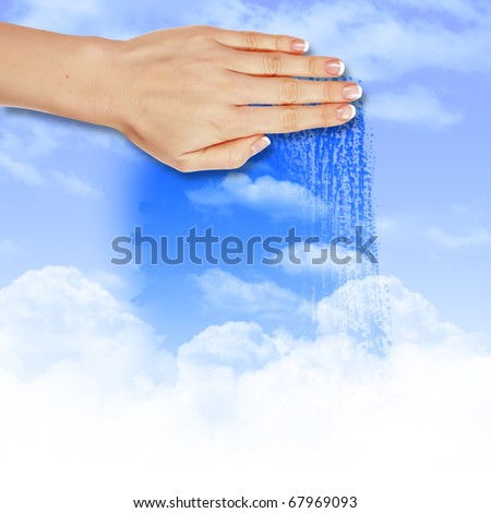 Hand wipes misted window at a blue sky - stock photo