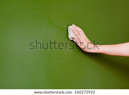 hand wipes the chalkboard, with a rag - stock photo