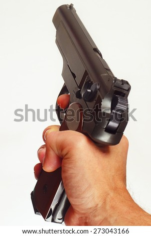 Hand with a army semi-automatic handgun close up - stock photo