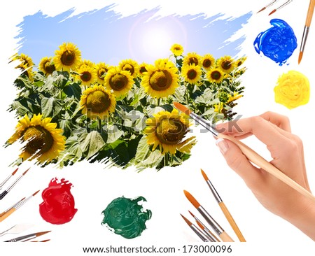 Hand with a brush painting summer landscape with sunflowers - stock photo