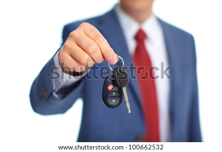 Hand with a Car keys. Isolated on white background.