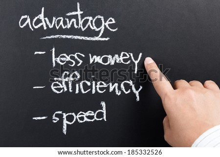 Hand with a competitive advantage of business concept written by chalk - stock photo