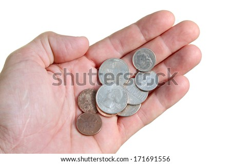 Hand with a few coins isolated on white - stock photo