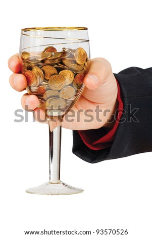 Hand with a glass of the money on a white background - stock photo