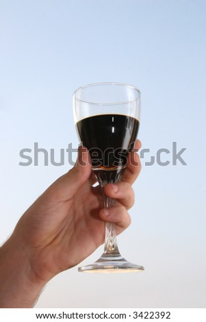 Hand with a glass of wine