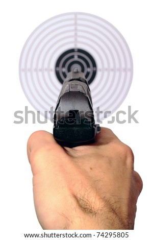 Hand with a gun pointing at the target - stock photo