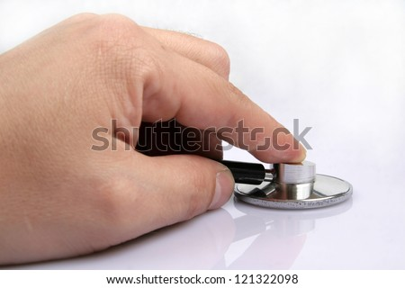 Hand with a medical stethoscope