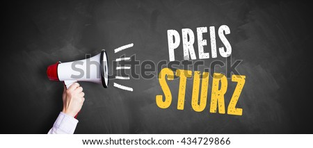 """hand with a megaphone in front of a blackboard with the message """"Price drop"""" in German - stock photo"""