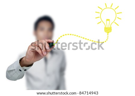 Hand with a pen drawing light bulb. - stock photo
