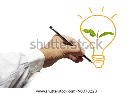 hand with a pencil drawing light bulb,young plant in a light bulb - stock photo