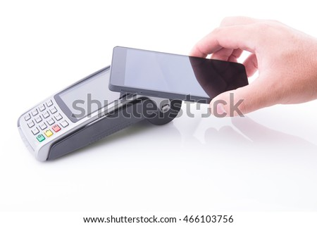 Hand with a smartphone making a payment on a POS terminal on white background