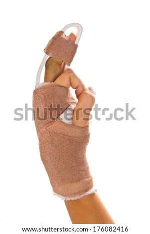 hand with a splint on the middle finger  - stock photo