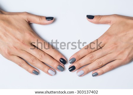 Hand with a stylish gray manicure isolated on white background - stock photo