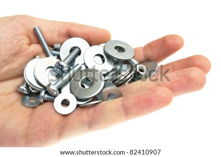 hand with a washer, nut, screw
