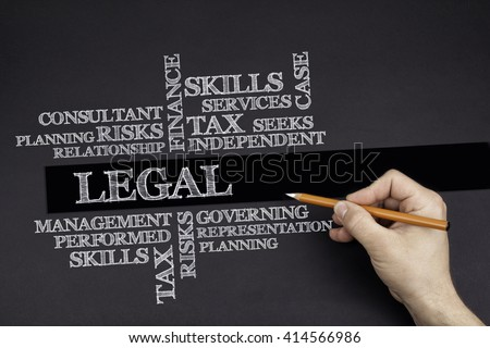 Hand with a white pencil writing: LEGAL word cloud