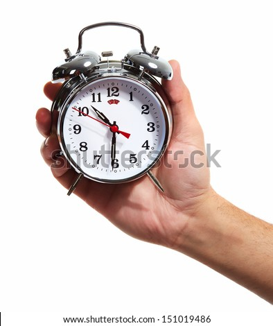 Hand with alarm clock. Isolated on white background.