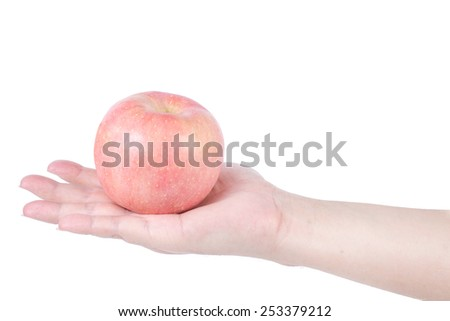 Hand with an apple isolated on white background. - stock photo