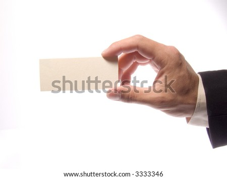 Hand with an empty beige card on a white background