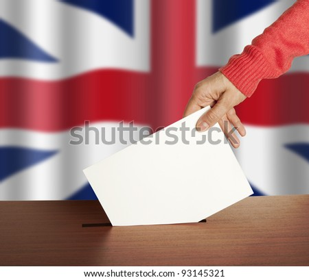 Hand with ballot and box on Flag of England - stock photo