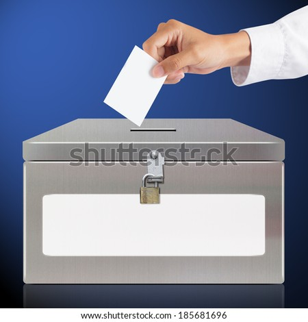 Hand with ballot and metal box, elections and democracy concept