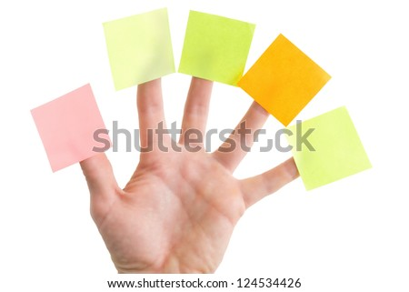 Hand with blank colorful post it notes, isolated on white