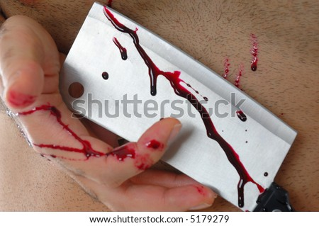 Hand with blood, holding a cleaver. - stock photo
