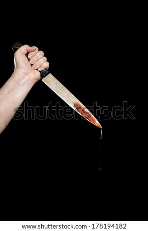 hand with bloody knife - stock photo