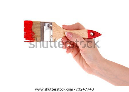 Hand with brush and red paint isolated on white - stock photo