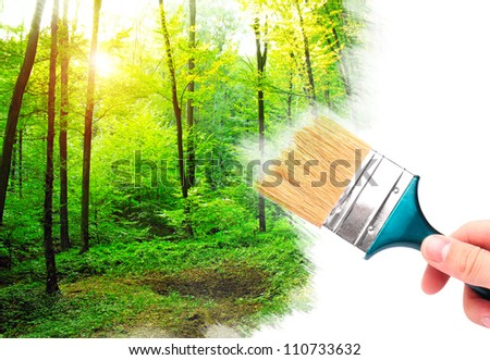 Hand with brush painting summer forest. - stock photo