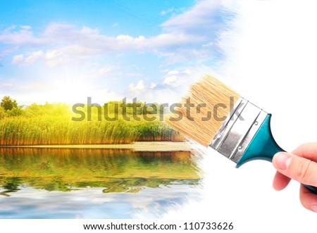 Hand with brush painting summer oak. - stock photo