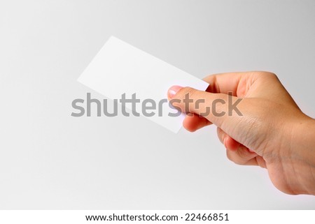 hand with business card - stock photo