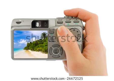 Hand with camera and landscape (my photo) isolated on white background