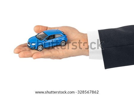 Hand with car isolated on white background - stock photo