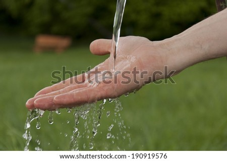 hand with clean drinking water